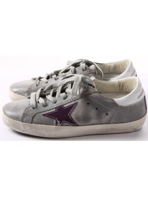 Grey sneakers with purple star